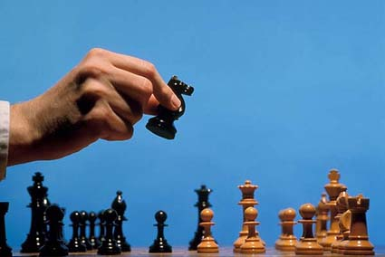 Strategy, decisions.  Making a chess move.